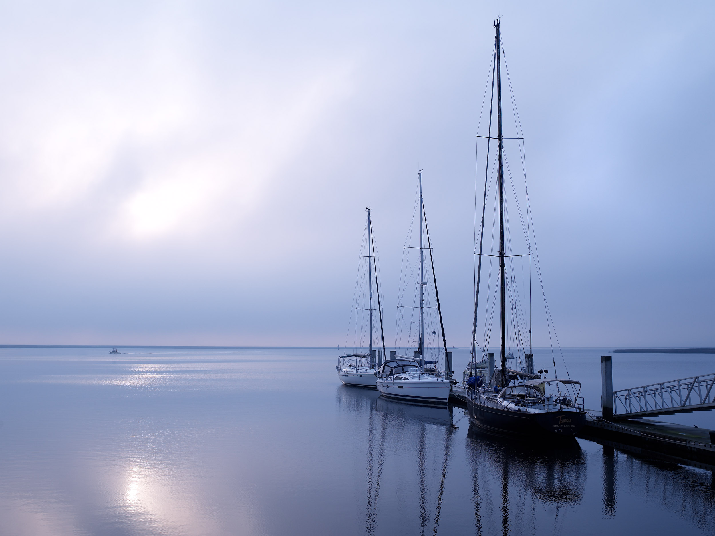 Sailboats in fog at sunrise, Steven Martine, travel and tourism photographer