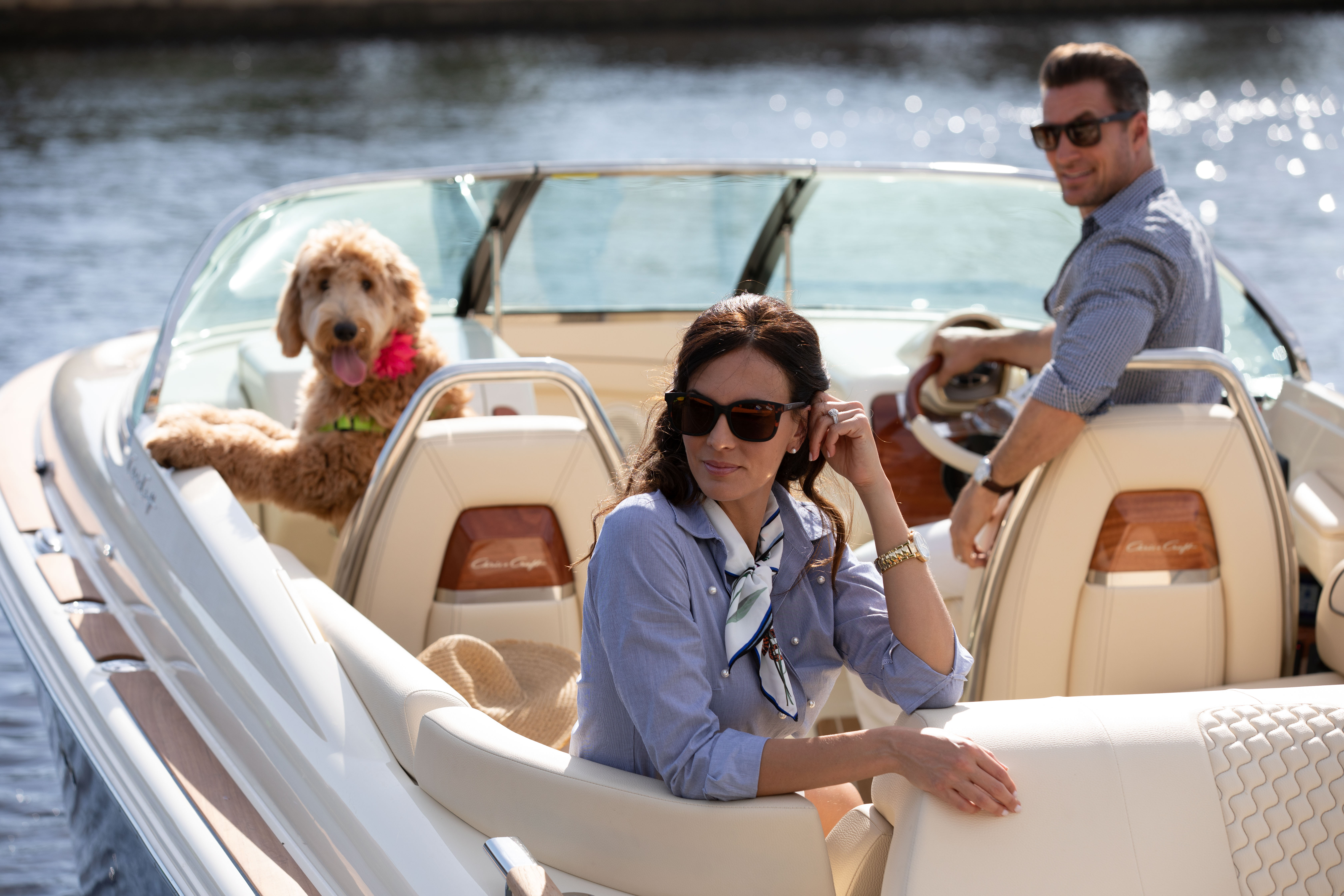 Family on boat with dog in Florida